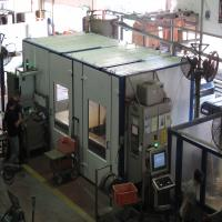 Acoustic closure for machine at metal forging factory